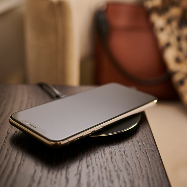Simple and cost-effective, the Brandstand CubieDot charging pad is the easiest way to add Qi Wireless charging technology to hotel guest rooms and lobby spaces.